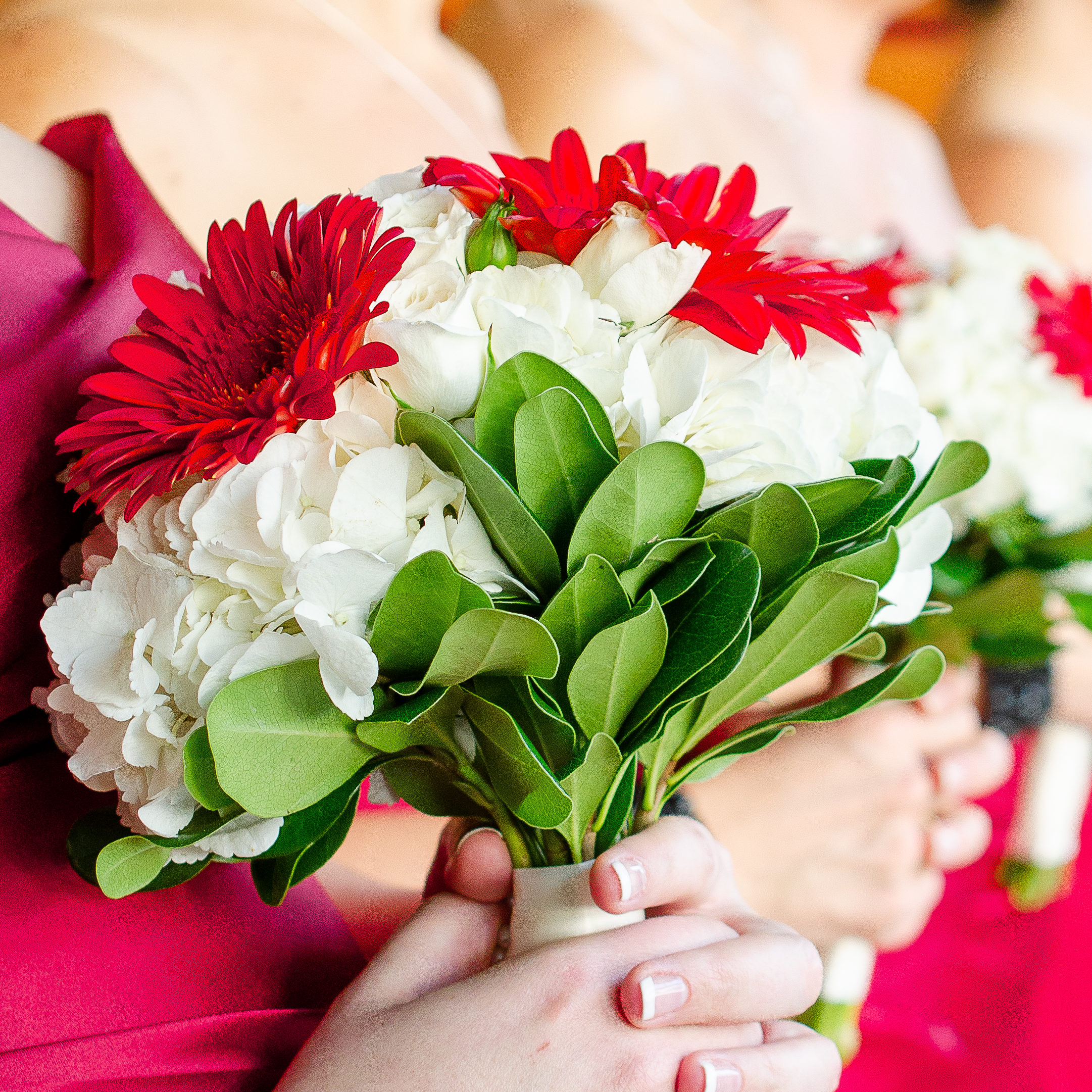 bridesmaid holding bouquets for weddings