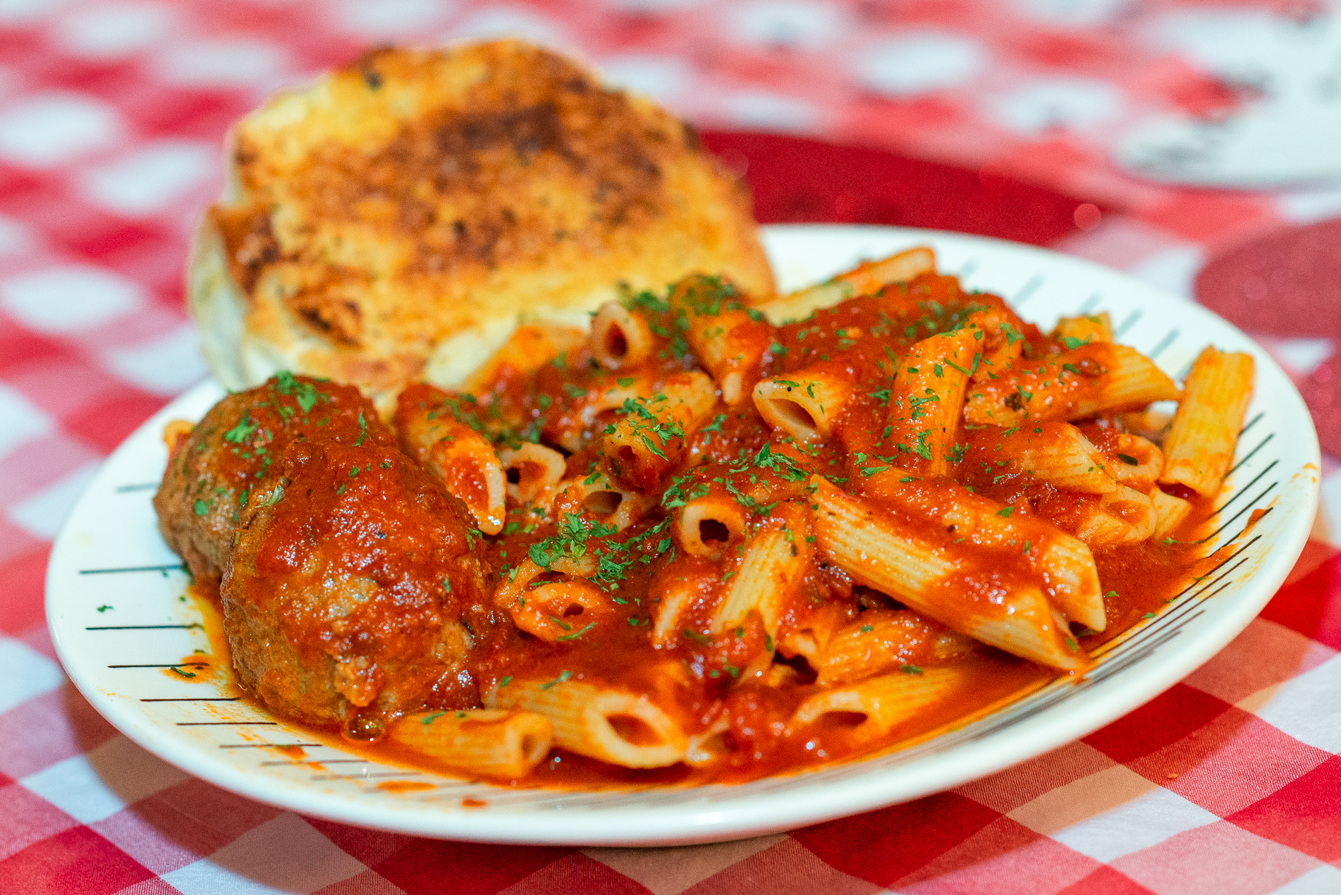 dining in at club belvedere penne pasta plate served at pasta wednesdays