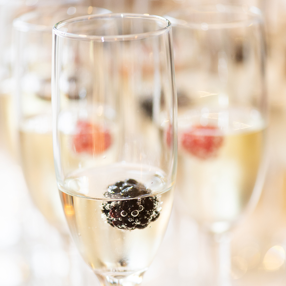 champagne glasses with fruit